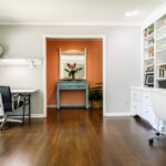 Colorful living room Home office area modern and clean and well organized with desks and chairs and a display bookcase