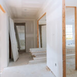 Interior construction of housing project with door installed construction materials